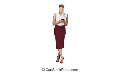 Attractive european female with smartphone in hand, touching scr
