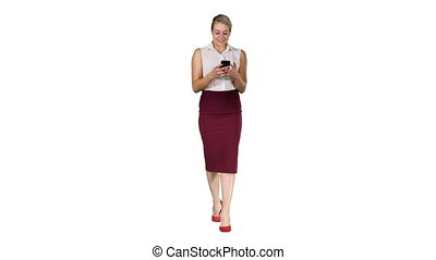 Beautiful young woman using her mobile phone on white...