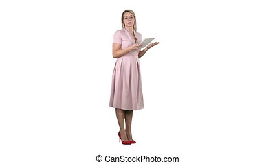 Female young woman in pink standing with tablet and giving...