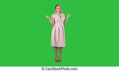 Girl in summer dress dancing to music on a Green Screen, Chroma Key.