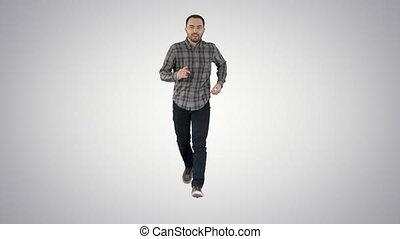 Man running on gradient background. - Full length portrait....