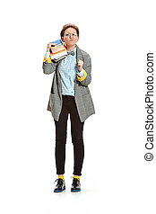 Full length portrait of a angry female student holding books isolated on white background