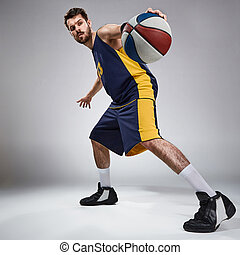 Full length portrait of a basketball player with ball - Full...