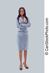 Full length portrait of a beautiful business woman standing with hands folded over white background.