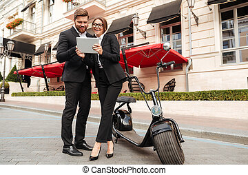 Full length portrait of a beautiful couple in smart clothes