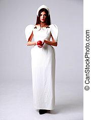 Full length portrait of a beautiful trendy woman in white dress