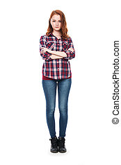Full-length portrait of a beautiful young red-haired girl looking at the camera