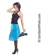 woman posing in a funky blue dress