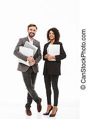 Full length portrait of a business couple holding folders