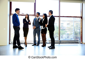 Full length portrait of a business people talking in the office