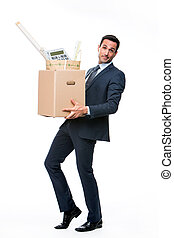 Full length portrait of a businessman carrying a cardboard box