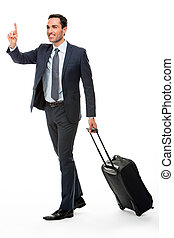 Full length portrait of a businessman with suitcase stopping a taxi