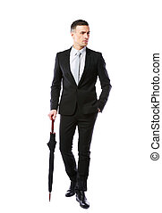 Full-length portrait of a businessman with umbrella over white background