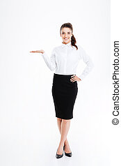 Full length portrait of a businesswoman holding copy space