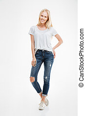 Full length portrait of a casual happy blonde woman standing