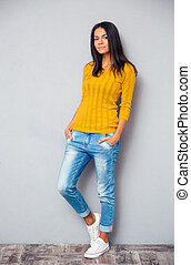 Full length portrait of a casual young woman
