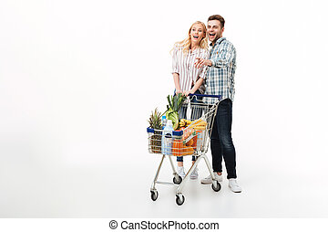 Full length portrait of a cheerful couple
