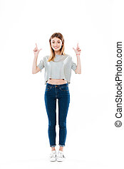 Full length portrait of a cheerful cute girl standing