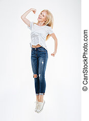 Full length portrait of a cheerful happy woman jumping