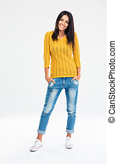 Full length portrait of a cheerful casual woman standing...