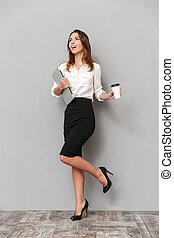 Full length portrait of a cheerful young business woman