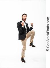 Full length portrait of a cheery happy man celebrating...