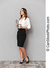 Full length portrait of a confident young business woman