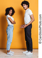 Full length portrait of a confused afro american couple