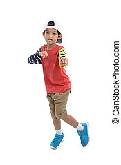 Full length portrait of a cool little boy in trendy clothes isolated on white background