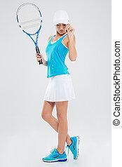 Full length portrait of a female tennis player