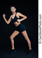 Full length portrait of a fitness woman