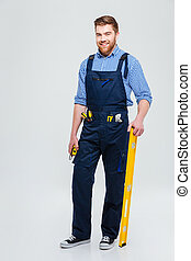 Full length portrait of a handsome male builder