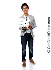 Full length portrait of a happy asian man with folders over white background