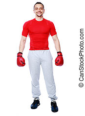 Full length portrait of a happy boxer standing over white background