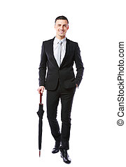 Full-length portrait of a happy businessman with umbrella over white background