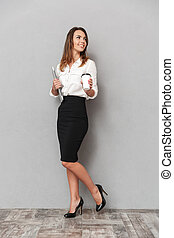 Full length portrait of a happy young business woman
