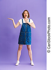Full length portrait of a happy young woman