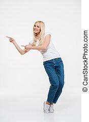 Full length portrait of a joyful attractive woman