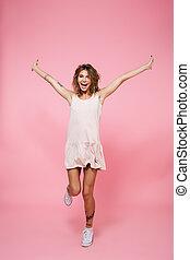 Full length portrait of a joyful excited girl in dress -...