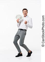 Full length portrait of a joyful man in white shirt