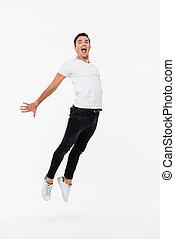 Full length portrait of a joyful man in white t-shirt