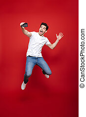 Full length portrait of a joyful young man