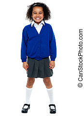 Full length portrait of a joyous African school girl. All against white background.