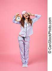 Full length portrait of a pretty girl dressed in pajamas -...