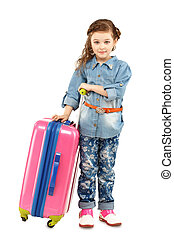 Full-length portrait of a pretty little girl with big pink suitcase on wheels