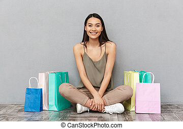 Full length portrait of a pretty young asian woman