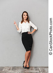 Full length portrait of a pretty young business woman