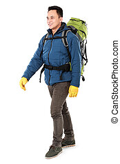 male hiker with backpack walking