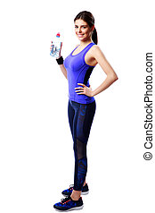 Full-length portrait of a smiling sport woman holding bottle with water isolated on white background