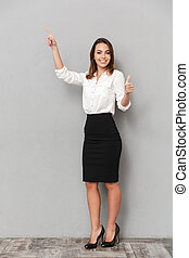 Full length portrait of a smiling young business woman
